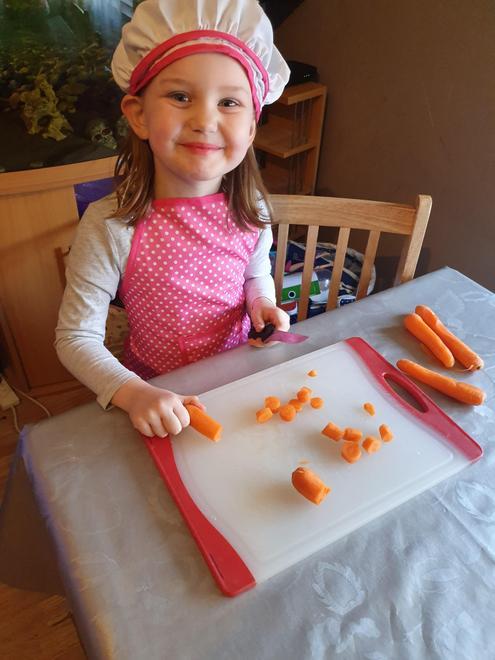 Chef Grace preparing her soup ingredients