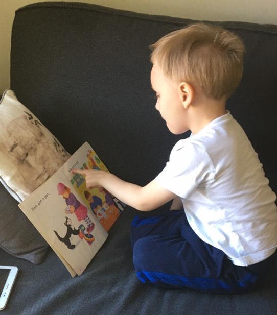 Janek reading his book