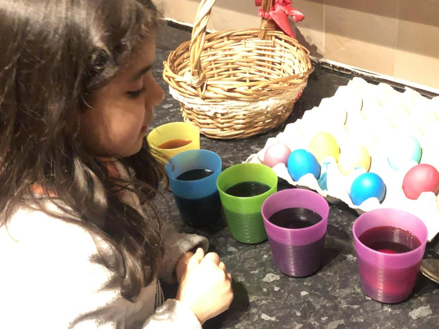 Rebecca dying Easter eggs
