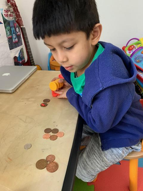 Mateo B counting with coins