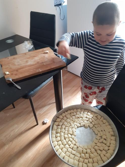 Dion helping his Mummy with the cooking