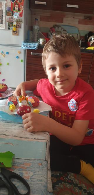 Maksim decorating Easter eggs