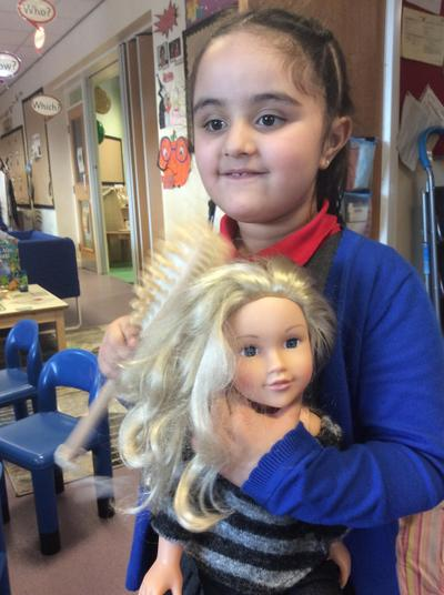 Brushing doll's hair