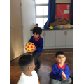 We practised throwing and catching during our warm up session