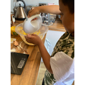 Mixing ingredients to make your own birthday cake.