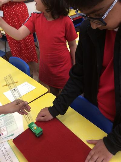 Which surface will the car travel fastest on?