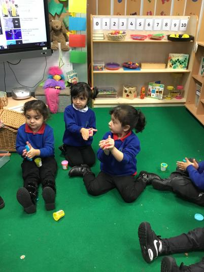 We use play dough to pat, squash, squeeze and poke the playdough!