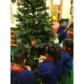 We had so much fun decorating the Christmas Tree!