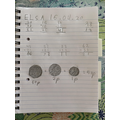 Elsa made 53p using 3 coins.