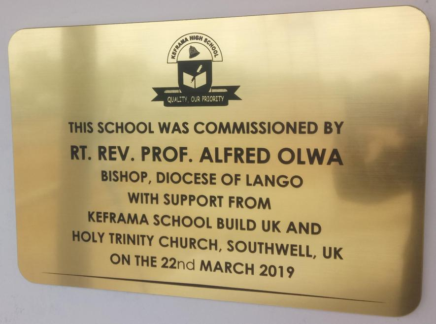 Plaque commemorating the opening of Keframa High School new building