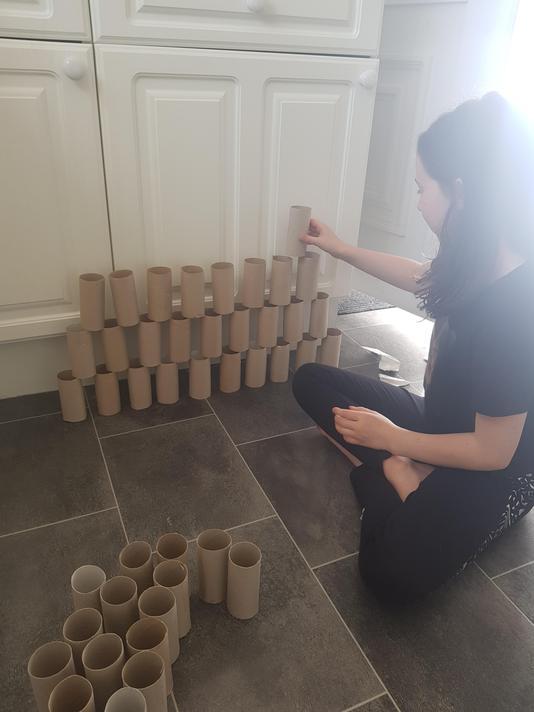 Holly Year 3 building pyramid of loo rolls
