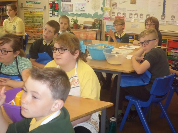 Pine Class listening intently to the instructions  from the chef online.