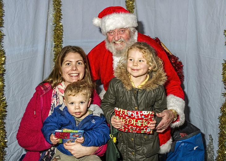 Children visiting Father Christmas in his Grotto