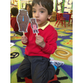 We practised retelling the story with puppets.