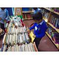 We like to choose a book to take home.