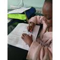 Rebecca completing a worksheet.