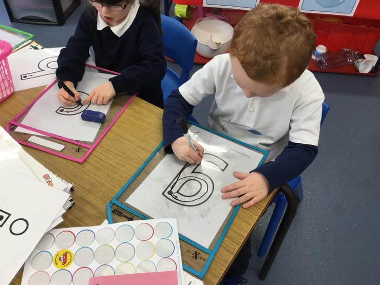 We use wipe-clean mats for letter formation.