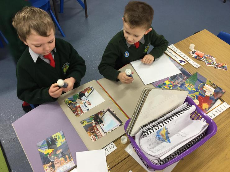 Conor and Lorcan helped Miss Guiney organise our play scrap-book.