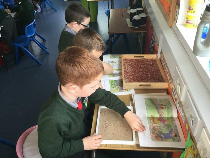 Pupils using the class Literacy table.