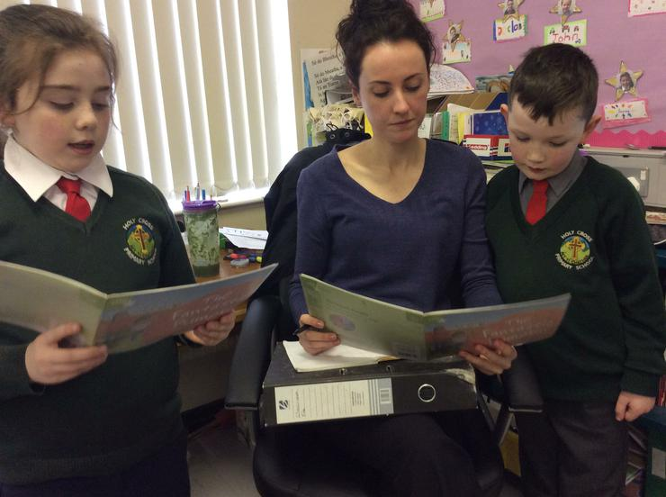 Connor and Mollie reading with Miss Malone