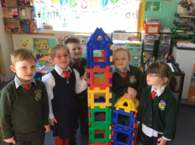 We split into groups and built two towers. We discussed which one was taller and by how many blocks.