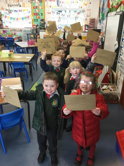 . We made St. Patrick's Day cards for our parents and posted them to our homes. We even wrote our addresses on the front of the envelopes. It was tricky!