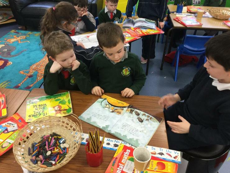 Older children reading to P3