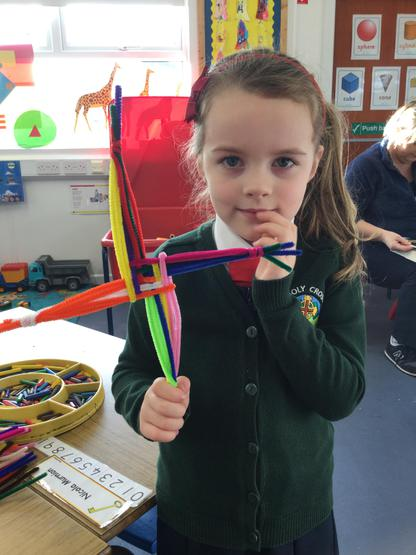 We made a colourful St. Brigid's cross with pipe cleaners for our classroom.