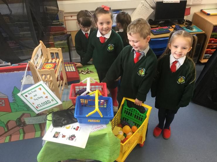 P1 have opened a farm fruit and veg shop and love taking turns to buy and sell farm goods.