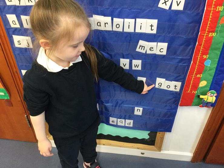 Rebecca used our pocket chart to spell out some CVC words