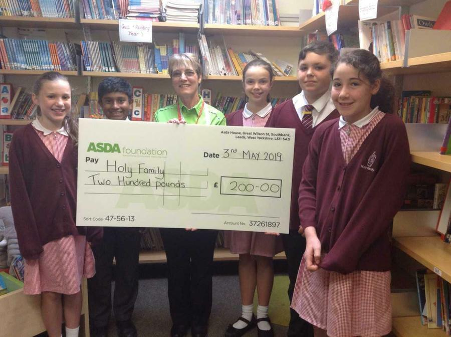 £200 cheque for the Library from Asda.