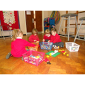 Reception working together to build a house.