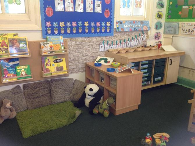 Share a book in the Birch class reading area.