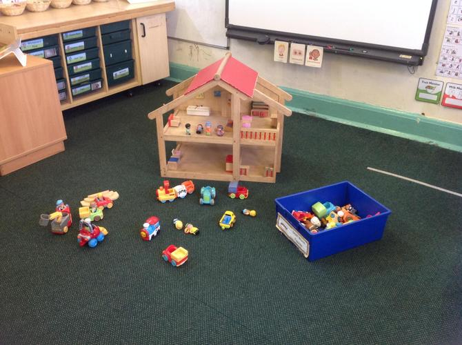 Dolls house and people in Birch classroom