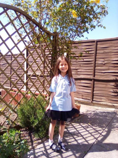 Wearing school uniform as she is missing school!