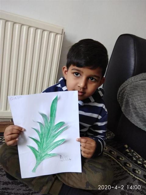 Drawing and cutting a palm leaf.