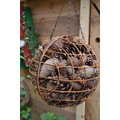 Love the pine cones and old hanging baskets