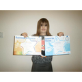 Sophie shows off her fantastic swimming awards...