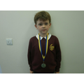Jack is proud of his tag rugby medal!