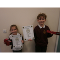Noah & Mara have earned their red belt in Karate!