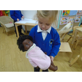 Pretending the doll is baby Jesus
