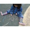 Sienna did a picture of her family with the chalks.