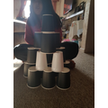 Noor created a cup tower. Would it hold up for the big bad wolf?