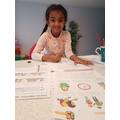 Tharuli enjoying her home learning tasks.