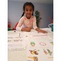 Tharuli enjoying her home learning tasks.