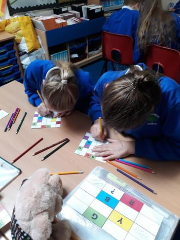 The girls are engrossed in their maths learning