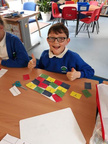 Feeling very happy with his maths success
