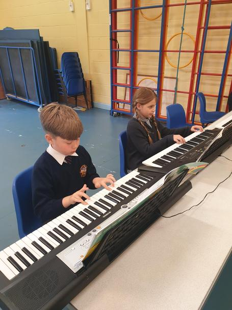 Year 4 pupils playing a beautiful tune in their keyboard lesson with Mr Hardy