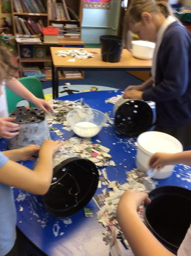 We used papier mache to cover the plant pots.