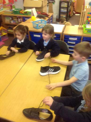 Learning to tie GIANT shoe laces